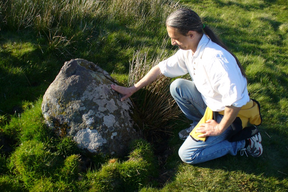 Fondling & puzzling over cup-marks on one of the stones