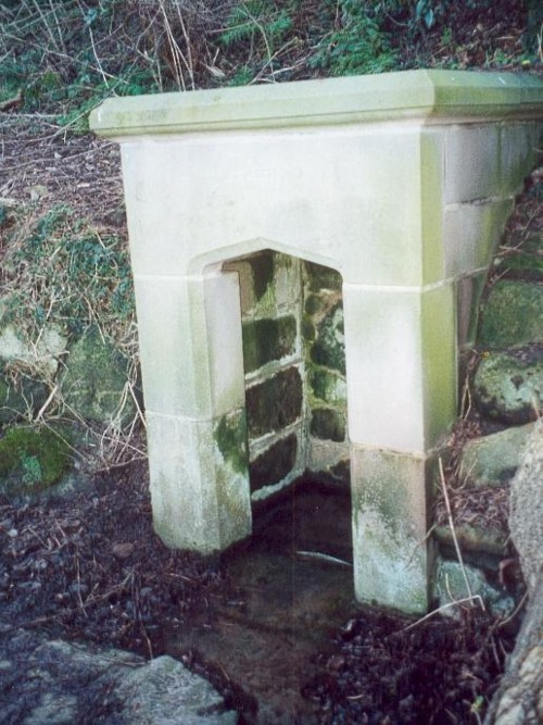 The restored holy well today, original stonework to rear with newer stone at the front