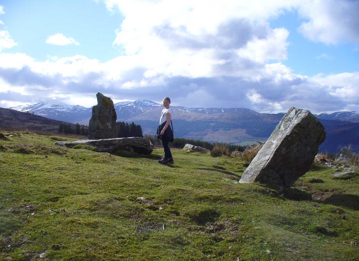 Lara between stones and mountains