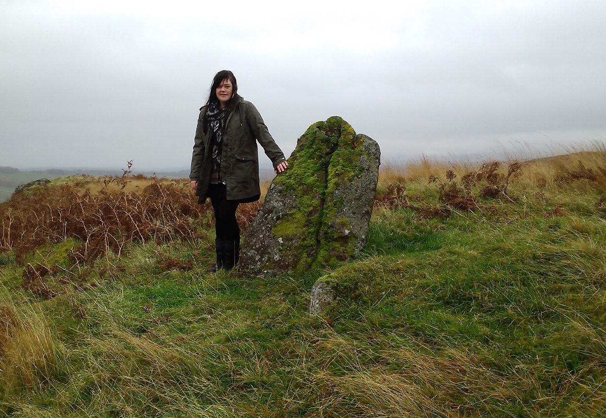 Lisa standing with the old stone