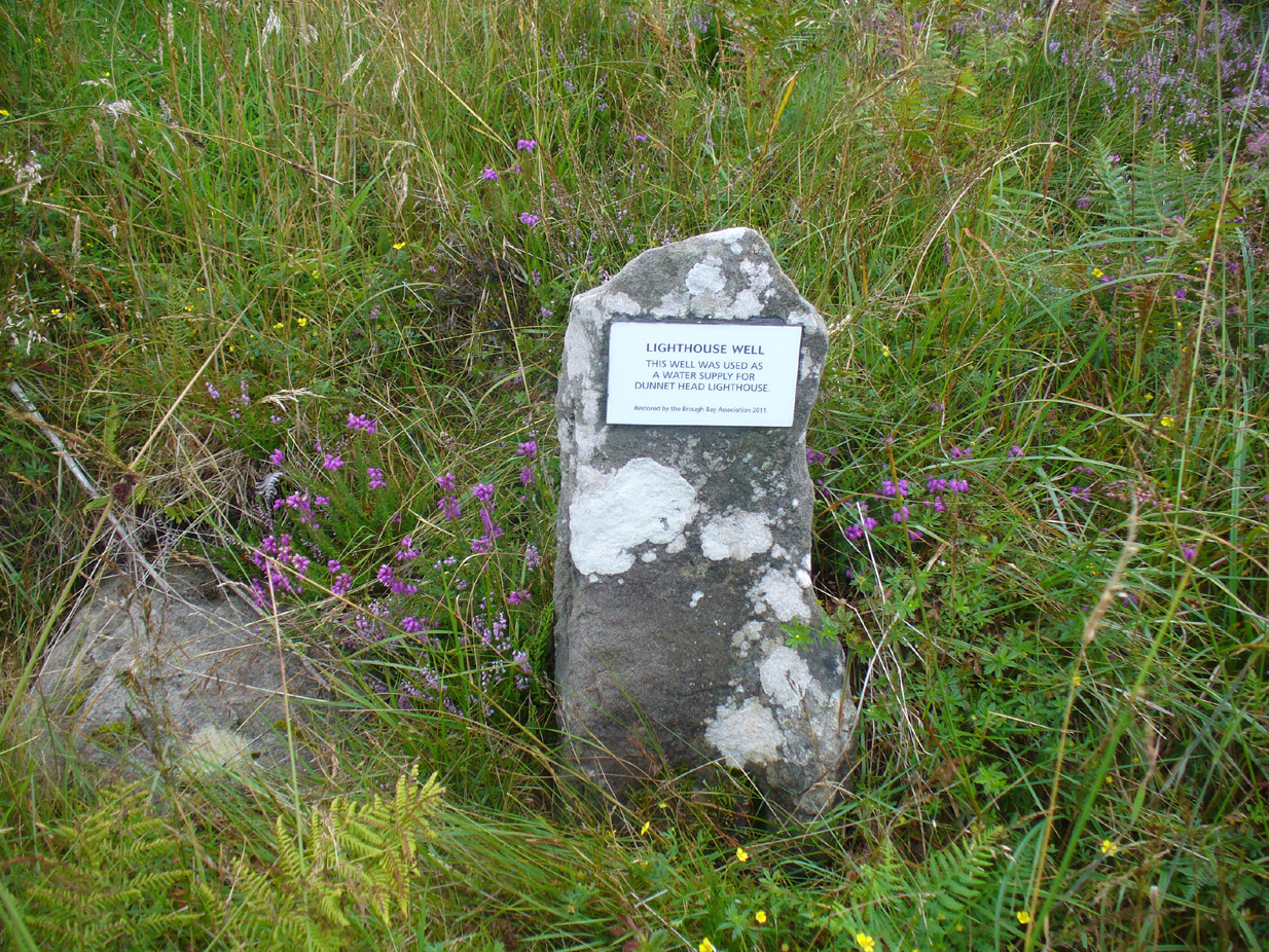 Stone & plaque by its side